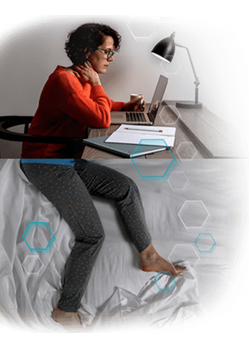 Woman with RLS sitting at her desk with restless legs